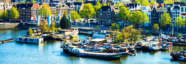 Aerial View of Amsterdam city on One Beautiful Sunny Day iStock_000036179194_Large-2