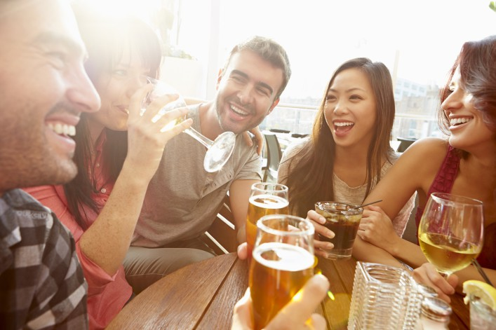 Group Of Friends Enjoying Drink At Outdoor Rooftop Bar_shutterstock_klein