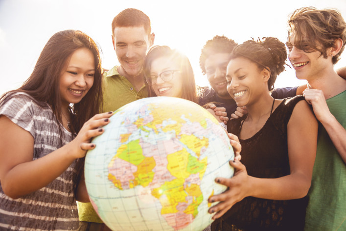 Group of friends holding an earth globe