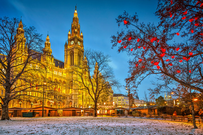 Illuminated Vienna Town Hall building at dusk