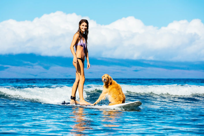 Attractive Young Woman Surfing with her Dog shutterstock_184580183-2