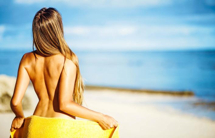 happy girl near swimming pool, bali resort hotel shutterstock_98776304-2