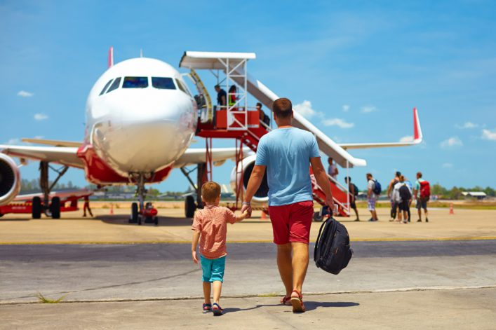 Father and son walking to the plane_Holiday_shutterstock_346036040