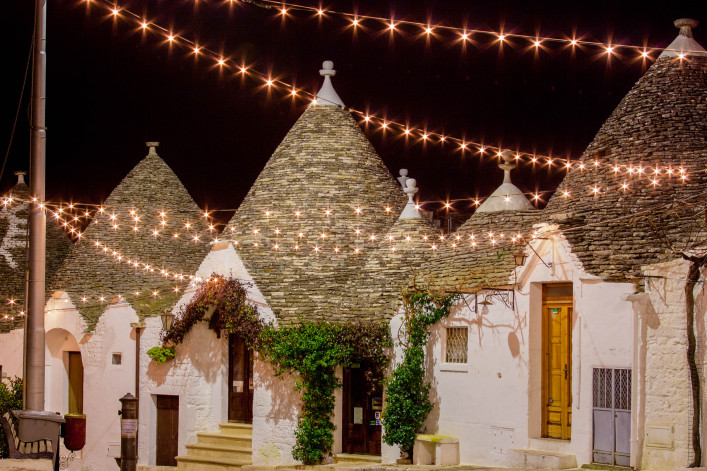 Alberobello trullo at night decorated with hundreds of little lights
