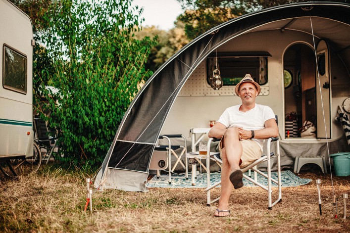 Man camping in his caravan at camping
