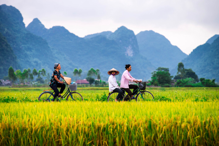 Vietnamese locals and their morning ride in Bac Son Valley