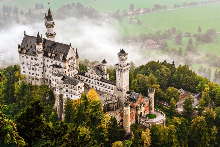 Neuschwanstein Castle shrouded in mist in the Bavarian Alps of Germany shutterstock_157079090-2