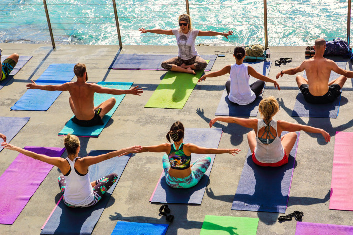 Yoga class beside the pool at Bondi Icebergs, Bondi Australia shutterstock_340176821 EDITORIAL ONLY Leah-Anne Thompson-2
