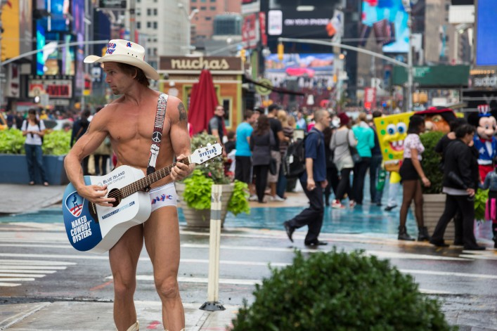 Naked Cowboy playing guitar on Times Square, New York City