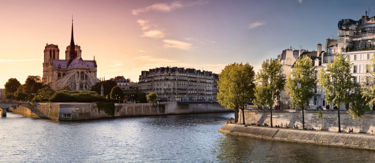 Notre Dame cathedral on Ile de la Cite in Paris, France seen from the Tournelle Bridge over River Seine. Part of Saint Louis Island on the right_shutterstock_128910458
