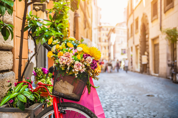 Bicycle with flowers in the old street in Rome, Italy shutterstock_440221486-2