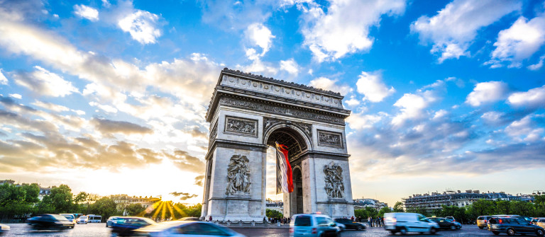 Arc de Triomphe and blurred traffic at sunset
