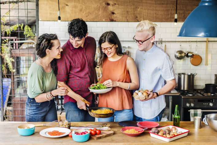 Friends Kitchen Cooking Dining Togetherness Concept shutterstock_391053622-2