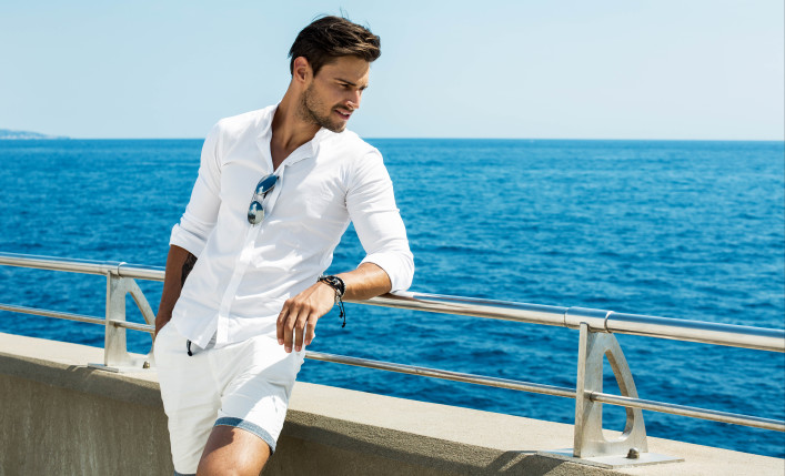 Handsome man wearing white clothes posing in sea scenery shutterstock_387823966-2