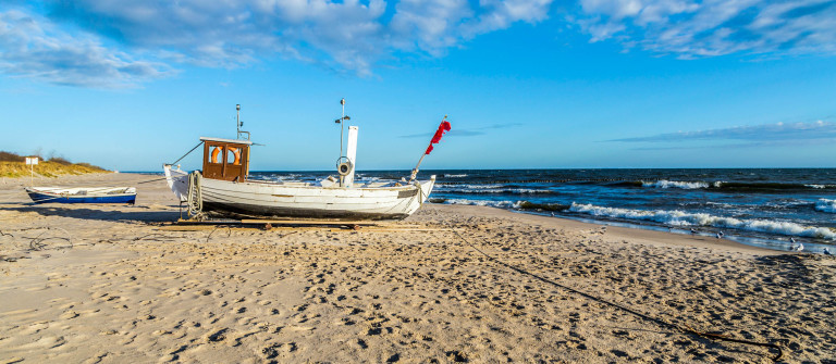 fishermans boat at the beach of the baltic sea