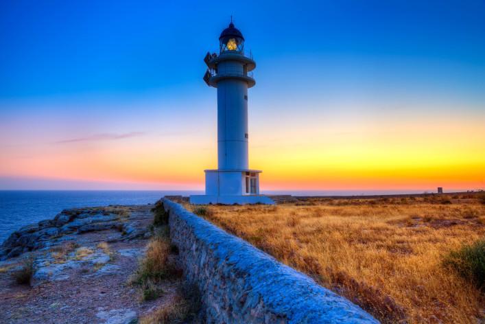 Formentera sunset in Barbaria cape lighthouse at Balearic Mediterranean islands shutterstock_185531699-2