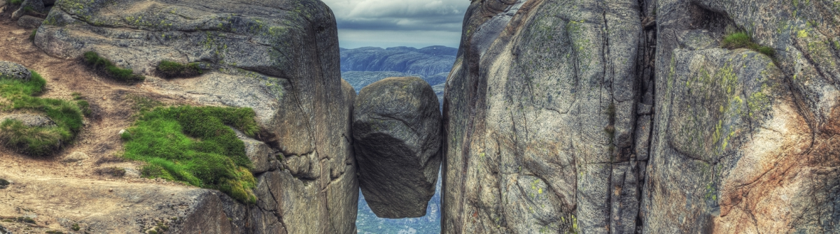 Kjerag Kjeragbolten rock in Kjerag Mountains, Norway