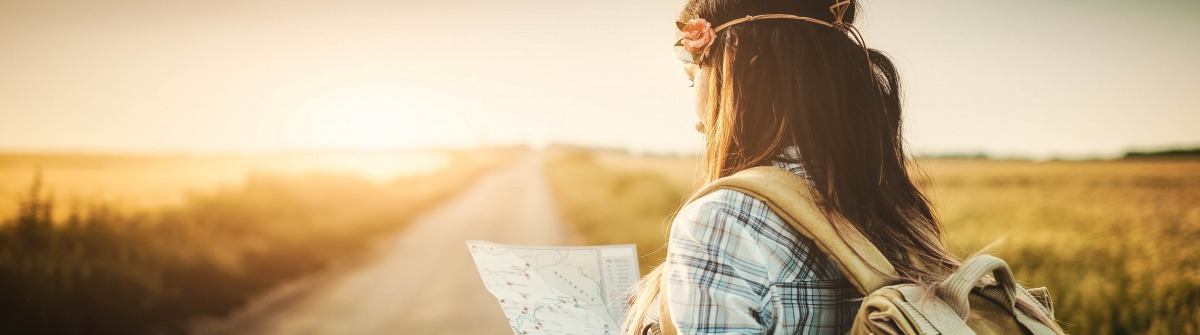 Attractive backpacker girl looking map