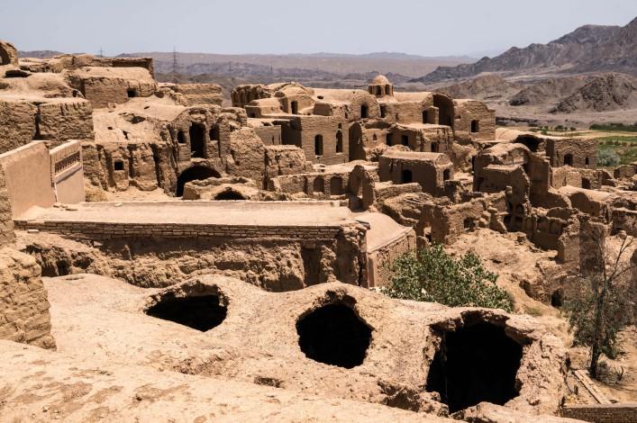 Deserted and crumbling mud-brick village of Kharanaq, Iran