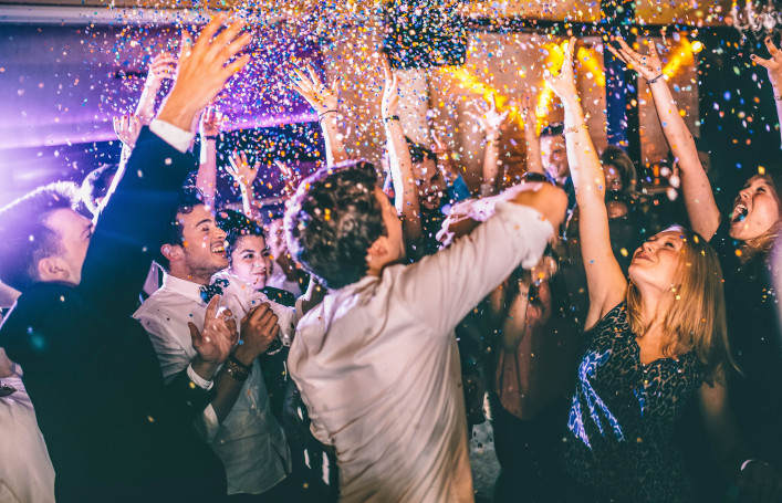 Group of hipsters throwing confetti at a party in celebrations