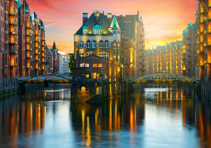 Old Speicherstadt in Hamburg illuminated at night. Sunset backgr