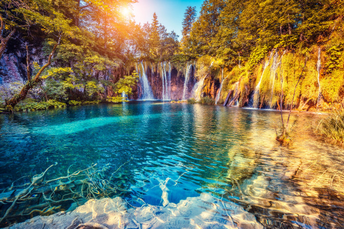 Majestic view on turquoise water and sunny beams in the Plitvice Lakes National Park Croatia shutterstock_266538056-2