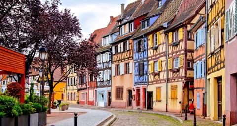 Quaint colorful houses of the Alsatian city of Colmar, France shutterstock_436894867-2