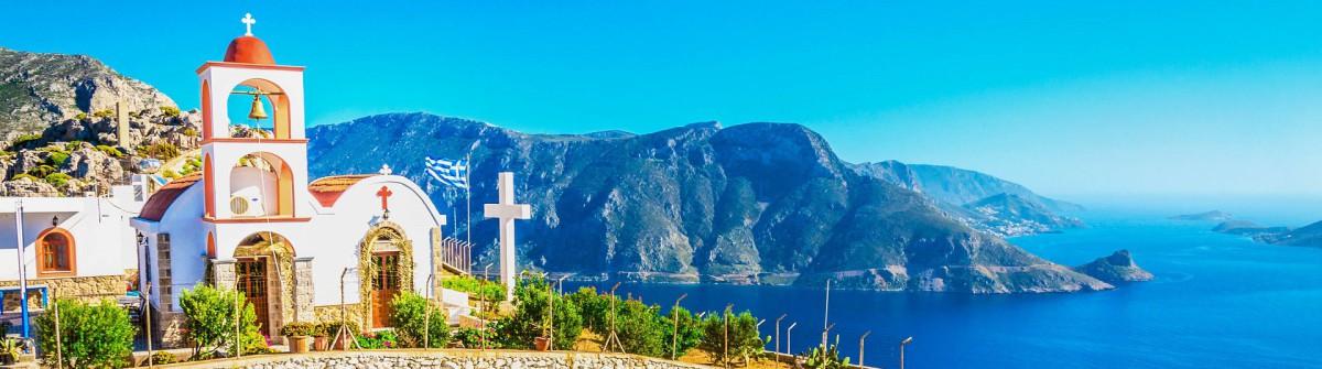Sea bay on Greek Island with white church