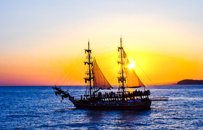 Two-masted sailing ship on the background of the setting sun iStock_000086822599_Large-2