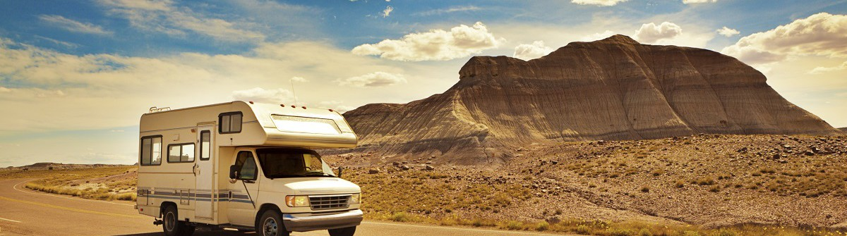 Camper Recreational Vehicle Touring Petrified Forest National iStock_000068404467_Large
