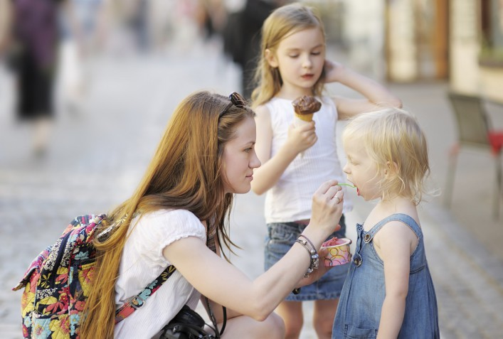 Mother and her daughters eating ice cream