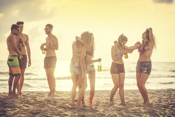Summer vacations group of friends party on the beach iStock_000083359031_Large