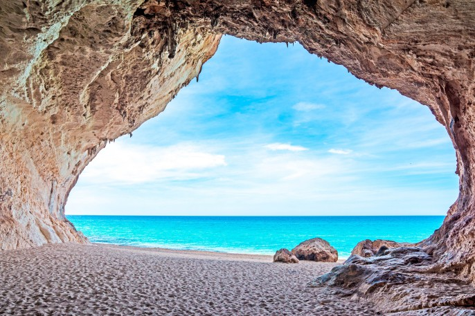 Cala Luna cave by the sea Sardinien Italien Italy shutterstock_192510971-2