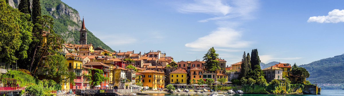 Colorful town Varenna seen from Lake Como on a sunny day shutterstock_152949956-2