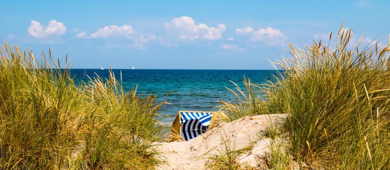 Hooded Beach Chair Between Dunes iStock_000044791036_Large-2