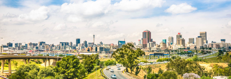 Wide angle view of Johannesburg skyline from the highways during