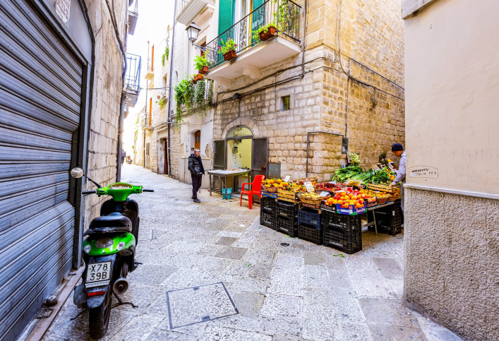 Local grocery and vegetable market on street in old town Bari, Italy shutterstock_383091307 EDITORIAL ONLY Littleaom-2