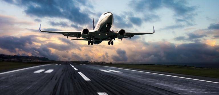 Passenger airplane landing at dusk iStock_000078999221_Large