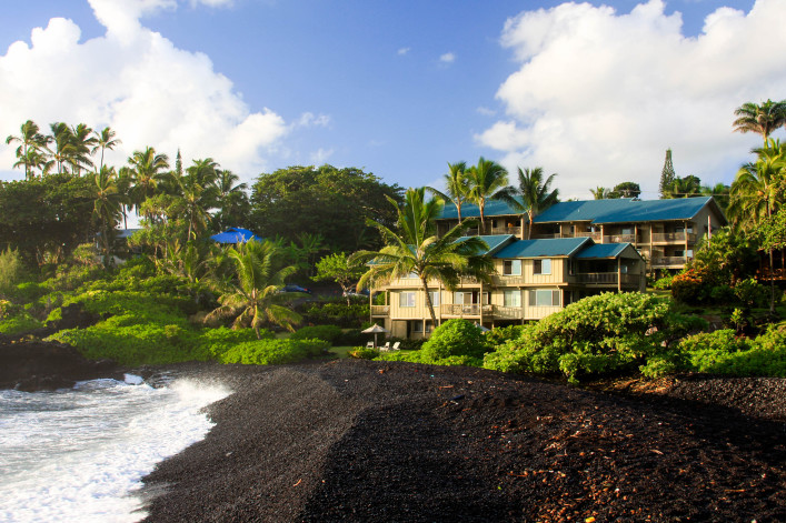 Resort hotel on black sand beach at Hana Maui
