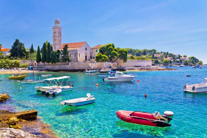 Turquoise sea of Hvar island, franciscian monastery view in Dalmatia, Croatia shutterstock_214114606-2