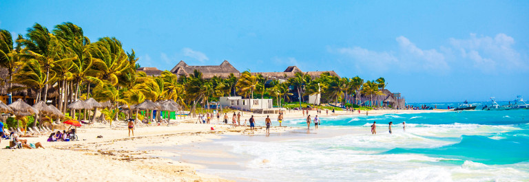 Vacationers on Playa Del Carmen Beach, Riviera Maya, Yucatan, Mexico iStock_000051782848_Large-2