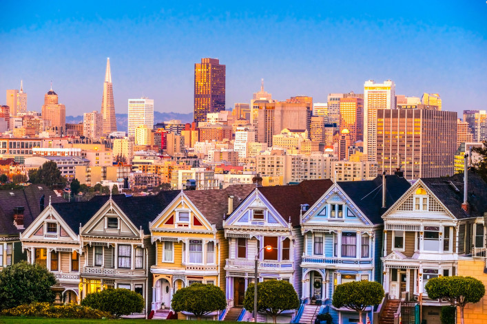 The Painted Ladies of San Francisco, California sit glowing amid