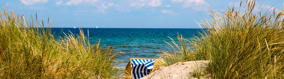 Hooded Beach Chair Between Dunes iStock_000044791036_Large-2
