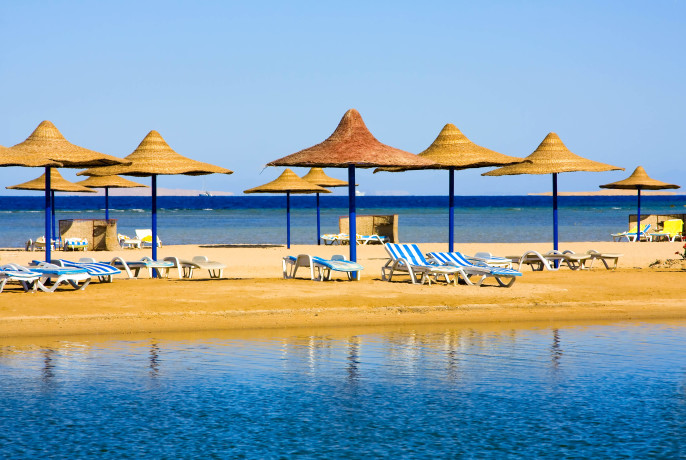 Straw umbrella on the beach, Hurghada  Egypt shutterstock_112595585-2