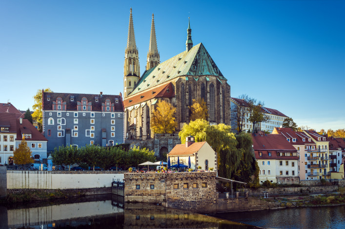 View to St. Peter's church, houses, Neisse river in Gorlitz on a sunny day in autumn shutterstock_132334931