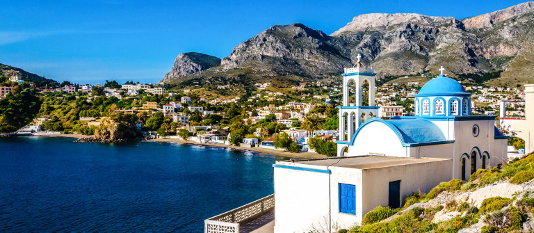 White church with azure blue dome Island, Greece