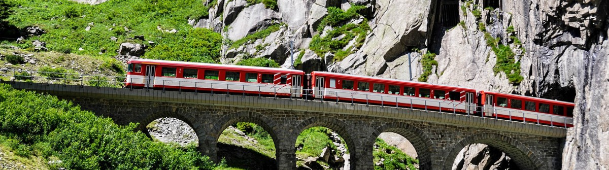 Alpine express passing bridge at St. Gotthard Pass in Switzerland shutterstock_371167400-2
