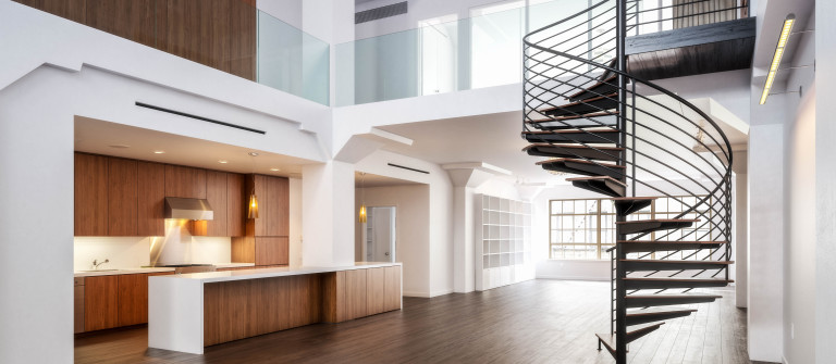 Empty room of residence with a spiral staircase shutterstock_154341227-2