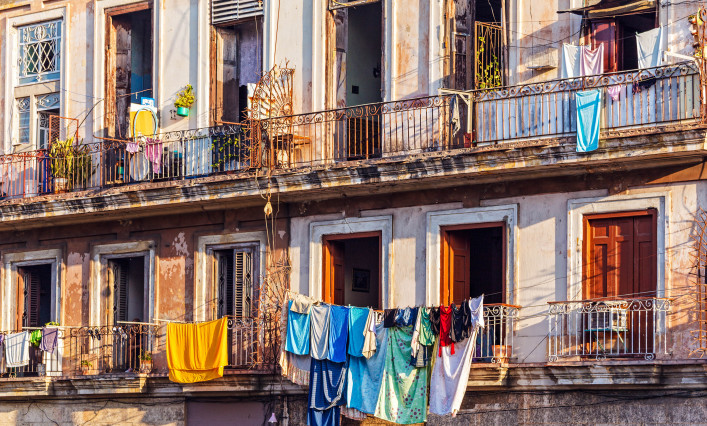 Fresh laundry on the balcony of old home, Havana, Cuba shutterstock_316014776-2