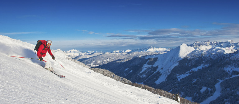 Austria,Salzburg Country,Mid adult man skiing on ski slope in winter